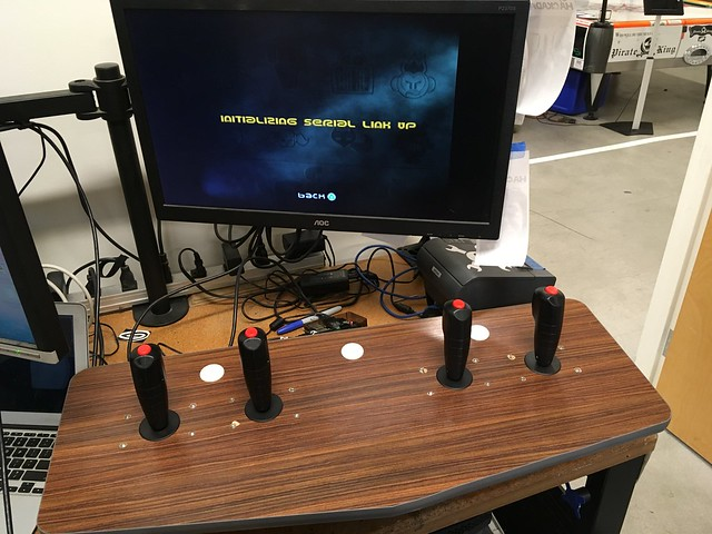 arcade console with four joysticks