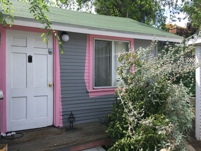 Front of a small house with pink accents